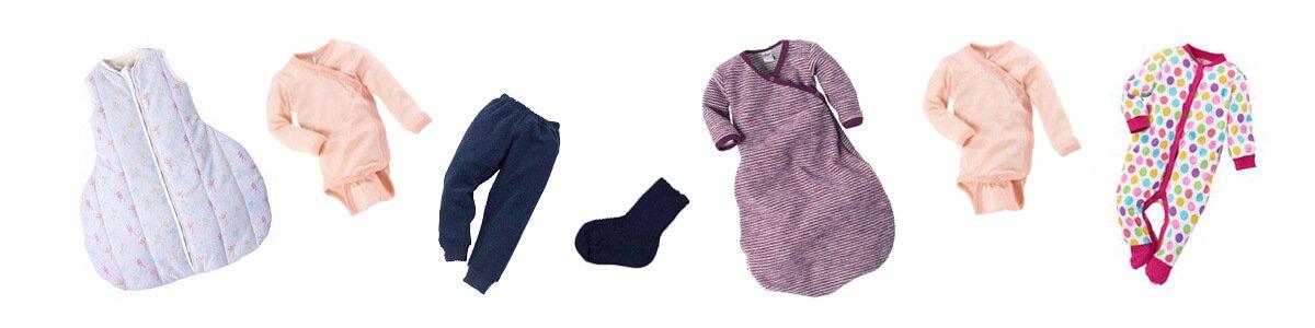 winterkleidung-baby-bett